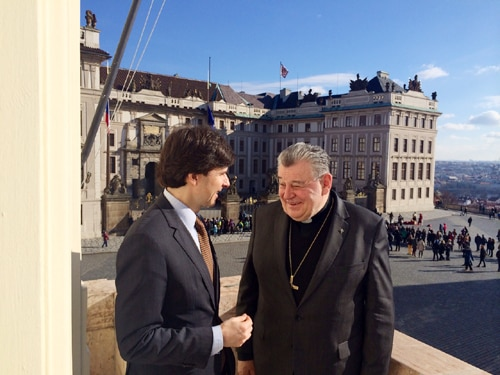 Ambassador Andrew Schapiro and Cardinal Dominik Duka, the Archbishop of Prague, talk on rooftop of the Prague Archdiocese.
