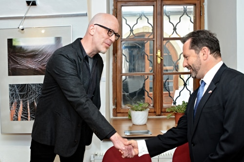 Deputy Chief of Mission Steven Kashkett (left) meets photographer Michal Borek at the opening ceremony of his photo exhibition in Pilsen on May 6, 2014.