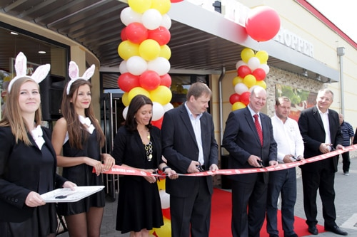 Ribbon-cutting ceremony at the opening of the first Burger King Drive-Thru in Prague.