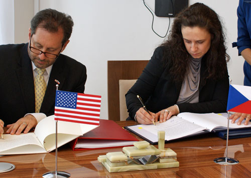 U.S. Chargé d'Affaires Steve Kashkett and Czech Deputy Minister of Finance Mrs. Simona Hornochová.