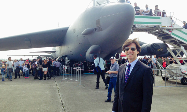 Ambassador Schapiro standing in front of the U.S. strategic bomber B-52H