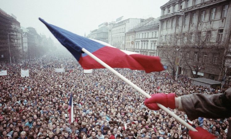 A young man holds Czechoslovak flag at the Wenceslas Square where gathered thousands of people in November 1989. Photo: David Turnley/CORBIS