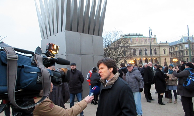 Ambassador Andrew Schapiro gives an interview to the Czech TV at the unveiling ceremony of Jan Palach Memorial in Prague.