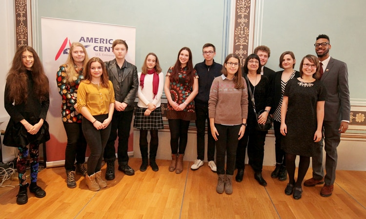 Deputy Cultural Attache Tony Jones welcomed to the American Center in Prague the winners of the 23rd Annual English-Language Essay Contest organized by the Society of Friends of the USA (SPUSA) .