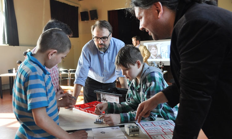 Klub Beztíže in Prague's neighbourhood of Zizžkov hosted a robotics workshop lead by Christian Gjørret, founder of the Prague's Café Neu Romance robot performance festival. The idea of a robotics workshop for youth came from the US Embassy's Public Affairs Section and the workshop was opened by Erin Kotheiher, the Cultural Attaché, and Noah Woodiwiss from its Economical Section.
