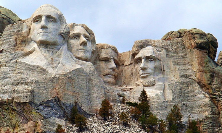The monumental granite sculpture located near Keystone, South Dakota was sculpted by Gutzon Borglum and later by his son Lincoln Borglum, plus 400 workers. The sculpture is 60 feet (18 m) tall of the heads of former United States presidents (in order from left to right) George Washington, Thomas Jefferson, Theodore Roosevelt, and Abraham Lincoln.