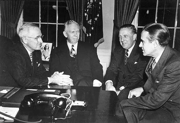 On November 29, 1948, President Harry S Truman conferred with the top leaders of the Marshall Plan—(left to right) George C. Marshall, Paul G. Hoffman (1891–1974), and Averell Harriman (1891–1986).